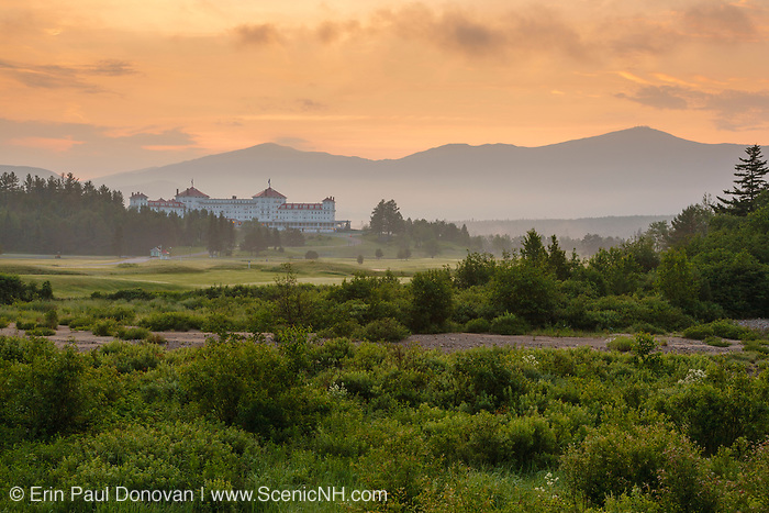 The Mount Washington Resort in Bretton Woods, New Hampshire at sunrise during the summer months. Bretton Woods is within the town of Carroll. Joseph Stickney built this grand resort in the early 1900s, and it opened in 1902. The old Maine Central Railroad traveled by this grand resort.