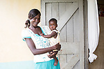 Comic relief 2015 Lenny Henry visit <br /> <br /> <br /> dorethy at home with her baby called loalina<br /> <br /> lenny visits