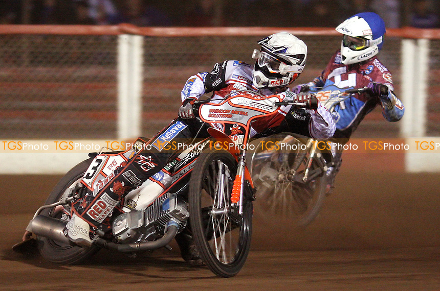 Heat 10: Stuart Robson (blue) and Simon Stead (white) - Lakeside Hammers vs Swindon Robins, Elite League Speedway at the Arena Essex Raceway, Pufleet - 18/05/12 - MANDATORY CREDIT: Rob Newell/TGSPHOTO - Self billing applies where appropriate - 0845 094 6026 - contact@tgsphoto.co.uk - NO UNPAID USE..
