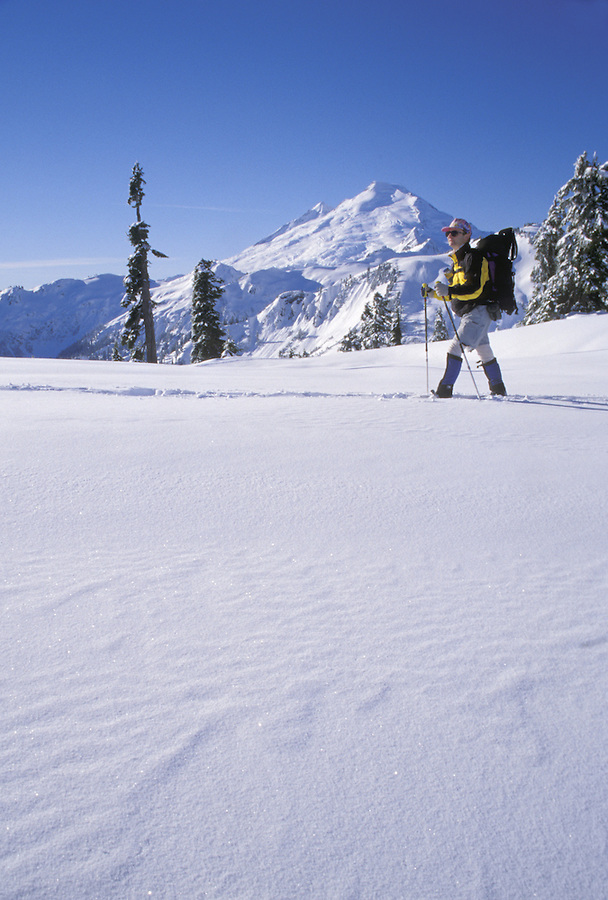 Man snowshoeing in mountains, Washington Cascade Mountains