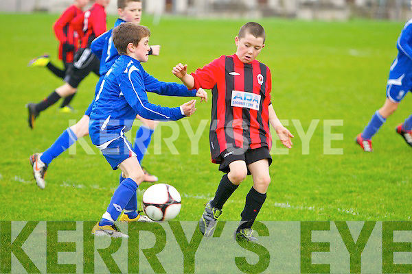 St Brendans Park's Thomas Burke and Killarney Athletic's Gary Baughan.