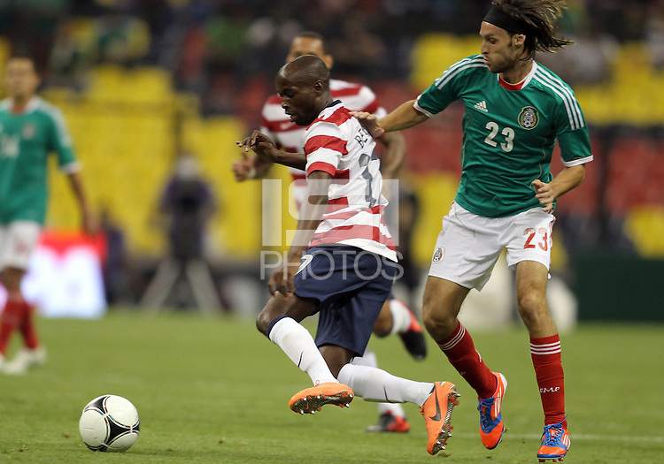 MEXICO CITY, MEXICO - AUGUST 15, 2012:  DaMarcus Beasley (17) of the USA MNT moves the ball away from Edgar Lugo (23) of  Mexico during an international friendly match at Azteca Stadium, in Mexico City, Mexico on August 15. USA won 1-0.