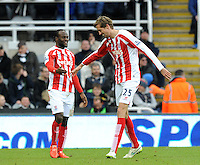 Peter Crouch of Stoke City celebrates scoring their first goal with Victor Moses of Stoke City (right)