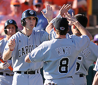 University of South Carolina infielder Andrew Crisp (2)  is congratulated after scoring a run in a game between the Clemson Tigers and USC Gamecocks on March 2, 2008, at Doug Kingsmore Stadium in Clemson. Photo by: Tom Priddy/Four Seam Images