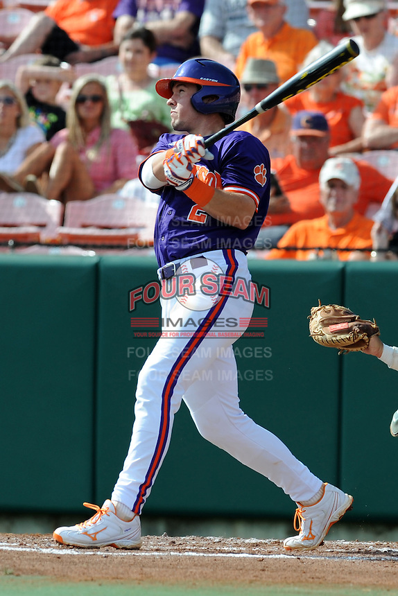 Shortstop Jason Stolz #2 swings at a pitch during a  game against the Miami Hurricanes at Doug Kingsmore Stadium on March 31, 2012 in Clemson, South Carolina. The Tigers won the game 3-1. (Tony Farlow/Four Seam Images)..