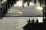 Fishermen relaxing on the Suriname River in the capital city of Paramaribo, Suriname.