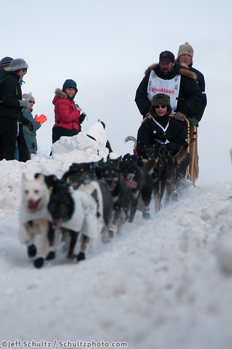 2010 Iditarod Ceremonial Start in Anchorage Alaska musher # 24 ART CHURCH  with Iditarider AARON CRAFT