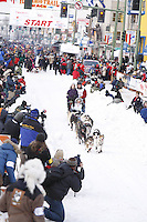Saturday March 6 , 2010  Ramey Smyth runs down 4th Avenue after leaving the start line during the ceremonial start of the 2010 Iditarod in Anchorage , Alaska