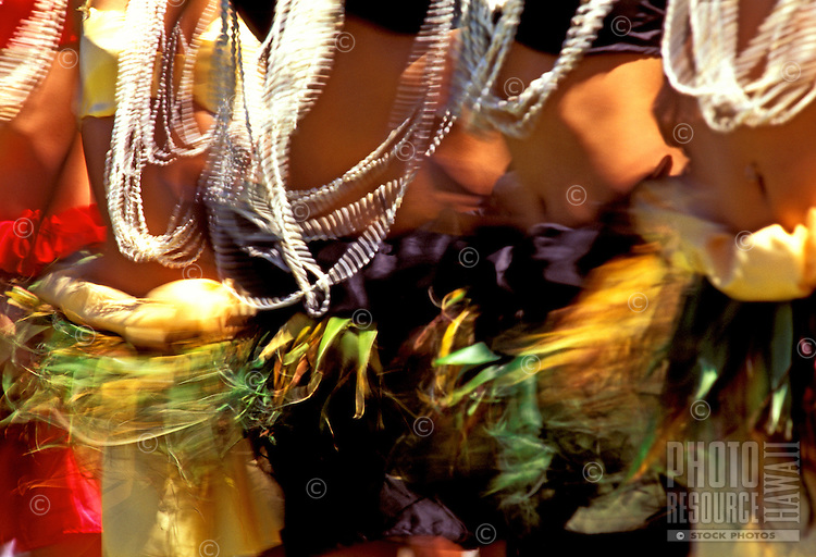 A flurry of color and movement from the gyrating hips and swinging shell leis of Tahitian dancers performing in Hilo on the Big Island.