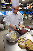 China, Hong Kong S.A.R..The Ritz-Carlton, Hong Kong. World's highest Dim Sum at Tin Lung Heen. Making of: Golden shrimp dumplings with bamboo shoots and asparagus.
