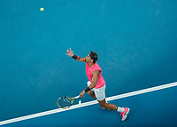 27th January 2020; Melbourne Park, Melbourne, Victoria, Australia; Australian Open Tennis, Day 8; Rafael Nadal of Spain serves to Nick Kyrgios of Australia during their game