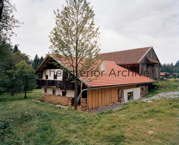 The exterior of the house has been restored in sympathy with the traditional architecture of the region