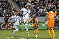 CARSON, CA - May 22, 2015: Los Angeles Galaxy forward Alan Gordon (9) heads the game winning goal during the LA Galaxy vs Houston Dynamo match at the StubHub Center in Carson, California. Final score, LA Galaxy 1, Houston Dynamo 0.