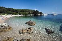 Greece, Corfu, near Agni: View along secluded beach on North East coast of island