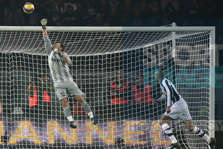 Julio Cesar of Inter Milan saves a point blank effort from David Trezeguet of Juventus