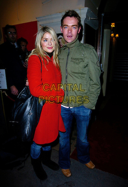 "HOLLY WILLOUGHBY & STEPHEN MULHERN.""Guys & Dolls"" VIP Performance, Picadilly Theatre, London, UK..January 24th, 2007.full length red coat jacket black bag purse oversized boots mittens green jeans denim.CAP/CAN.©Can Nguyen/Capital Pictures"