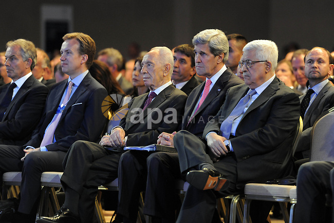 U.S. Secretary of State John Kerry, Palestinian President Mahmud Abbas and Israeli President Shimon Peres (L) during the opening session of the World Economic Forum on the Middle East and North Africa, on the shores of the Dead Sea, 55 kms southeast of Amman, capital of Jordan, on May 26, 2013. Photo by Thaer Ganaim