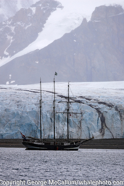 Three masted wooden sailing schooner transferring tourists to glacier Kongsfjord Ny Alesund Spitsbergen Barents sea North east Atlantic