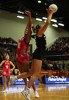 NZ goalshoot Irene Van Dyk takes a pass under pressure from Geva Mentor during the International  Netball Series match between the NZ Silver Ferns and World 7 at TSB Bank Arena, Wellington, New Zealand on Monday, 24 August 2009. Photo: Dave Lintott / lintottphoto.co.nz