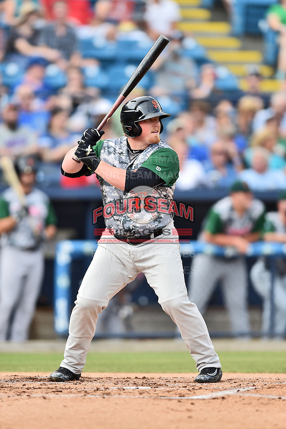 Augusta GreenJackets first baseman Skyler Ewing (25) awaits a pitch during a game against the Asheville Tourists at McCormick Field on July 21, 2016 in Asheville, North Carolina. The GreenJackets defeated the Tourists 6-3. (Tony Farlow/Four Seam Images)