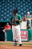 Greensboro Grasshoppers right fielder Isael Soto (15) at bat during a game against the Lakewood BlueClaws on June 10, 2018 at First National Bank Field in Greensboro, North Carolina.  Lakewood defeated Greensboro 2-0.  (Mike Janes/Four Seam Images)