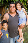 Nicaraguan father poses with two children, Isla Ometepe, Nicaragua