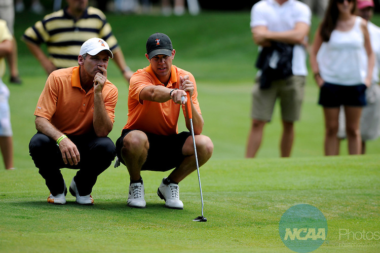 6 JUN 2010: Kevin Tway of Oklahoma State Univeristy lines up a putt with coach Mike McGraw during the 2010 NCAA Men's Division I Golf Championship at The Honors Course in Chattanooga, TN. Augusta State University defeated Oklahoma State University in match play to win the national title. ©Brett Wilhelm/NCAA Photos