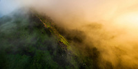 Mist rolls over the Pali on O'ahu at sunset.
