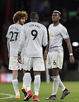 Paul Pogba talks with Romelu Lukaku & Marouane Fellaini of Man Utd during the Premier League match between Bournemouth and Manchester United at the Goldsands Stadium, Bournemouth, England on 18 April 2018. Photo by Andy Rowland.