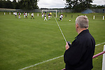 A spectator with a transistor radio watching Gala Fairydean Rovers (in white) in action during their team's inaugural match in the Scottish Lowland Football League away to Whitehill Welfare at Ferguson Park. Gala were formed in 2013 by an a re-amalgamation of Gala Fairydean and Gala Rovers, the two clubs having separated in 1908 and Gala's Netherdale ground in Galashiels in the Scottish Borders had one of only two stands designated as listed football stands in Scotland. Whitehill won the match, the first-ever in the newly-formed Lowland League by 4 goals to 2.