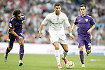 Real Madrid's Cristiano Ronaldo (c) and Malaga's Marcos Alberto Angeleri (l) and Roberto Rosales during La Liga match. September 26,2015. (ALTERPHOTOS/Acero)