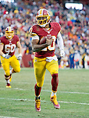 Washington Redskins quarterback Robert Griffin III (10) scores a touchdown in the fourth quarter against the Dallas Cowboys at FedEx Field in Landover, Maryland on Sunday, December 28, 2014.  The Cowboys won the game 44-17.<br /> Credit: Ron Sachs / CNP