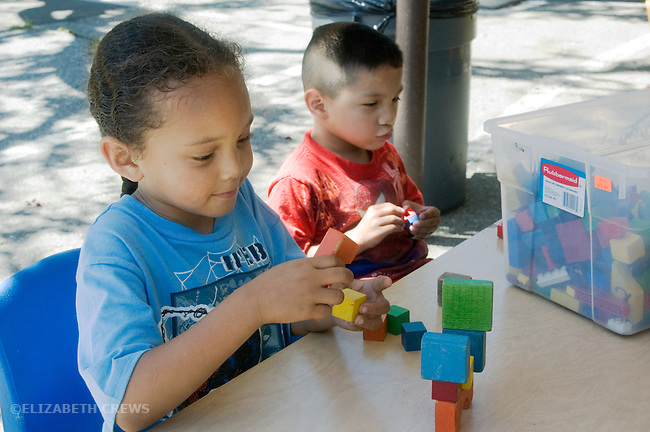 Berkeley CA  Four-year-olds involved in parallel block play at bilingual, Spanish-English preschool