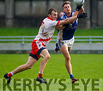 Colm Ó Muircheartaigh of An Ghaeltach and Templenoe's Brian Crowley in action during the Intermediate football final.