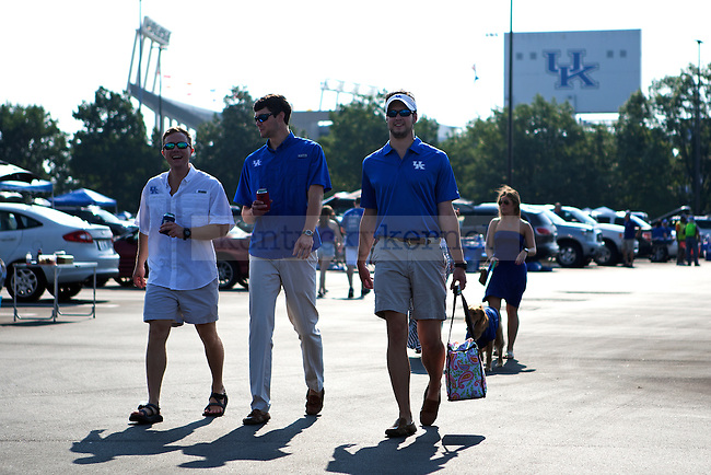 Fans arrive for tailgating prior to the game between the University of Kentucky vs. University of Tennessee Martin football game at Commonwealth Stadium in Lexington, Ky., on Saturday, August 30, 2014. Photo by Michael Reaves | Staff