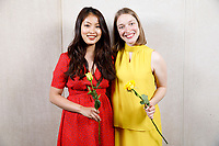 Contestants Nicolette Chin of Singapore, left, and Lise Vandersmissen of Belgium pose at a photo booth during the opening reception and dinner of the 11th USA International Harp Competition at Indiana University in Bloomington, Indiana on Wednesday, July 3, 2019. (Photo by James Brosher)