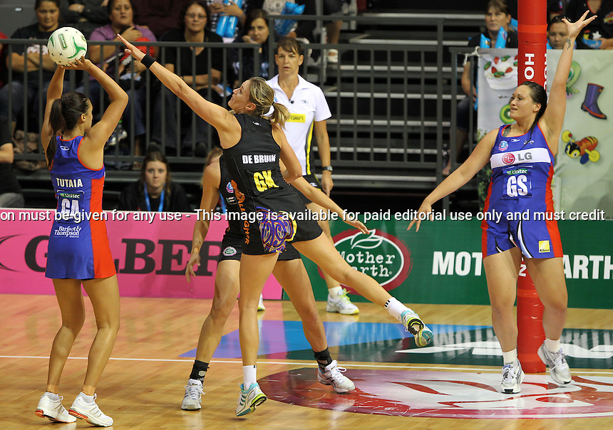 08.04.2012 Magic's Leana de Bruin and Mystics Maria Tutaia in action during the ANZ Champs netball match between the Magic and Mystics played at Claudelands Events Centre in Hamilton. Mandatory Photo Credit ©Michael Bradley.