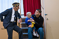 A member of the Young-Budd Post 171 of the American Legion in Westerville, Ohio, talks with a man and his child during an open house for its new home on East College Street. Photo Copyright Gary Gardiner. Not be used without written permission detailing exact usage.
