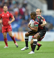 Kenya's Biko  Wolfgang Adema is tackled by Wales's Lee Williams<br /> <br /> Kenya Vs Wales - men's placing 5-8 match<br /> <br /> Photographer Chris Vaughan/CameraSport<br /> <br /> 20th Commonwealth Games - Day 4 - Sunday 27th July 2014 - Rugby Sevens - Ibrox Stadium - Glasgow - UK<br /> <br /> © CameraSport - 43 Linden Ave. Countesthorpe. Leicester. England. LE8 5PG - Tel: +44 (0) 116 277 4147 - admin@camerasport.com - www.camerasport.com