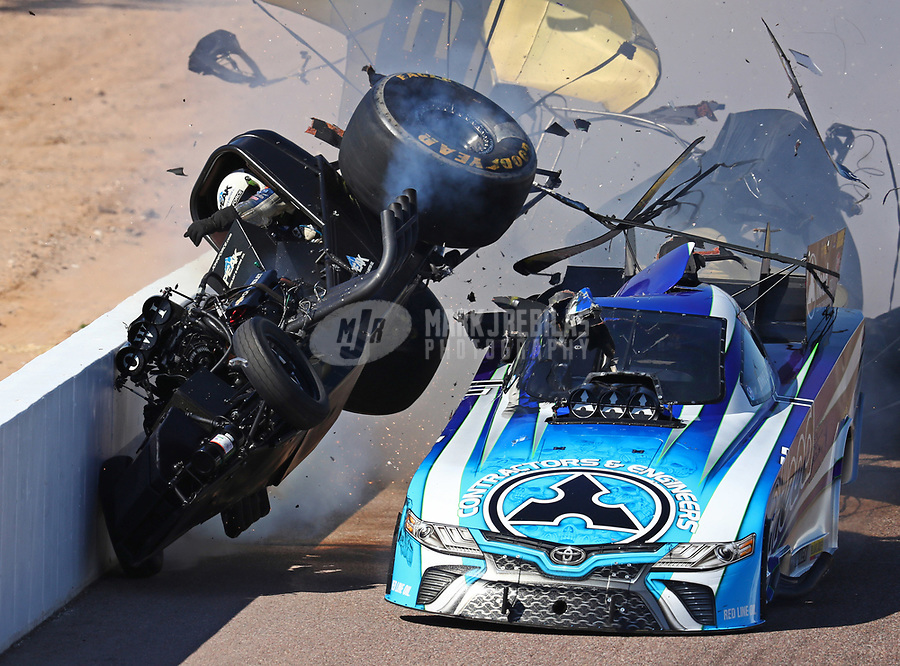 Feb 25, 2018; Chandler, AZ, USA; NHRA funny car driver John Force (left) crashes into Jonnie Lindberg during the Arizona Nationals at Wild Horse Pass Motorsports Park. Mandatory Credit: Mark J. Rebilas-USA TODAY Sports