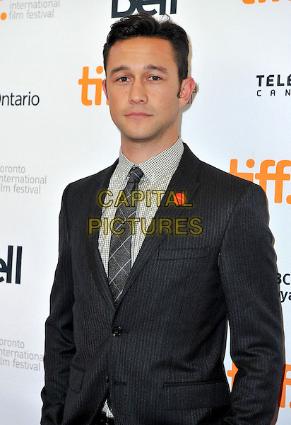 Joseph Gordon-Levitt<br /> &quot;Don Jon&quot; Premiere - 2013 Toronto International Film Festival held at Princess of Wales Theatre, Toronto, Ontario, Canada.<br /> September 10th, 2013<br /> TIFF half length black grey gray suit check shirt tie red button badge<br /> CAP/ADM/BPC<br /> &copy;Brent Perniac/AdMedia/Capital Pictures