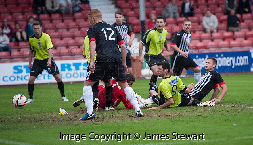 Pars' Luke Johnston (on ground, right) scores their second goal.