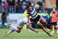 Anthony Watson of Bath Rugby is tackled by Don Armand of Exeter Chiefs. Aviva Premiership match, between Bath Rugby and Exeter Chiefs on October 17, 2015 at the Recreation Ground in Bath, England. Photo by: Patrick Khachfe / Onside Images