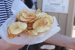 Fried potato chips from carnival food stall.