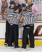 The officials, Jack Millea, John Gravallese, Chris Low and Bob Bernard, go through their fist bumping ritual that you can see most officiating crews perform prior to each period. - The Boston College Eagles defeated the visiting Boston University Terriers 5-2 on Saturday, December 4, 2010, at Conte Forum in Chestnut Hill, Massachusetts.