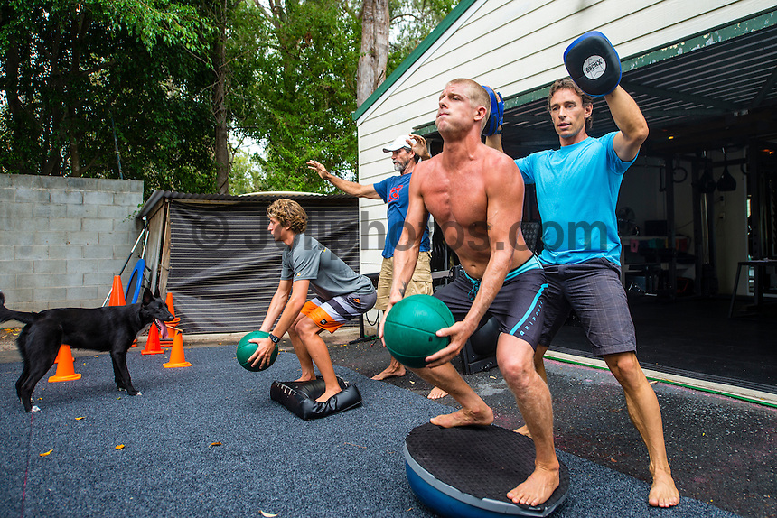 The current World Surfing Champion Mick Fanning and Leo Fioravanti working with medicine balls and assisted by coaches Phil MacNamara and Nam Baldwin during a training session at Coolangatta, Queensland, Australia on Tuesday February 18, 2014