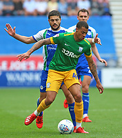 Preston North End's Lukas Nmecha shields the ball from Wigan Athletic's Sam Morsy<br /> <br /> Photographer David Shipman/CameraSport<br /> <br /> The EFL Sky Bet Championship - Wigan Athletic v Preston North End - Monday 22nd April 2019 - DW Stadium - Wigan<br /> <br /> World Copyright © 2019 CameraSport. All rights reserved. 43 Linden Ave. Countesthorpe. Leicester. England. LE8 5PG - Tel: +44 (0) 116 277 4147 - admin@camerasport.com - www.camerasport.com