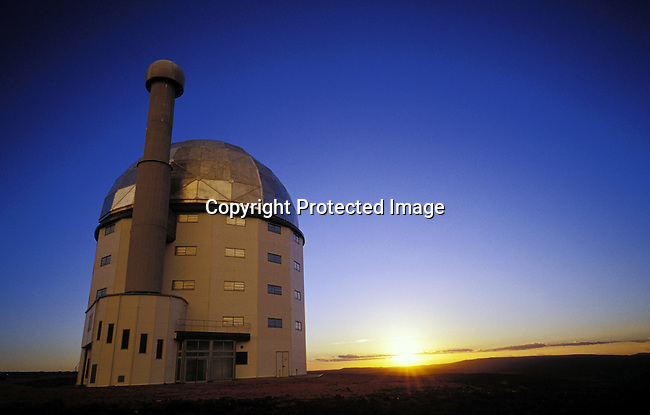 diastro00269 Astrology telescope, SALT, space, thunder, sky, colorful, sunset,.The (SALT) Southern African Large Telescope, the largest in the southern hemisphere being built in Sutherland, a small rural farming town in the Karoo , South Africa. The town has seen an increasing number of visitors and investors coming to the town opening Bed and Breakfasts and buying property. The telescope will help scientists to view stars and galaxies a billion times too faint to be visible to the naked eye..©Per-Anders Pettersson/iAfrika Photos
