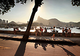 BRAZIL, Rio de Janiero, Bar Urca, people sit on a Sea Wall on the Atlantic Ocean