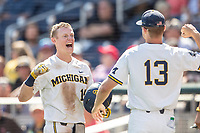 Michigan Wolverines first baseman Jimmy Kerr (15) celebrates with teammate Dominic Clementi (13) after hitting a home run during Game 11 of the NCAA College World Series against the Texas Tech Red Raiders on June 21, 2019 at TD Ameritrade Park in Omaha, Nebraska. Michigan defeated Texas Tech 15-3 and is headed to the CWS Finals. (Andrew Woolley/Four Seam Images)